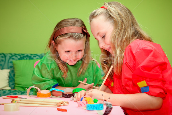 happy children playing drawing and making craft in class at kind Stock photo © godfer