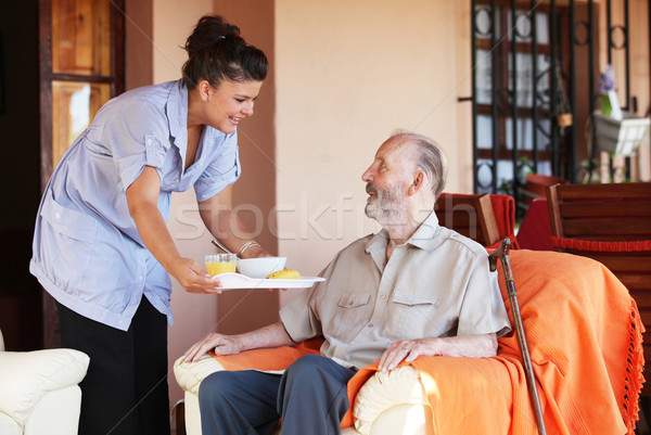 elderly senior being brought meal by carer or nurse Stock photo © godfer