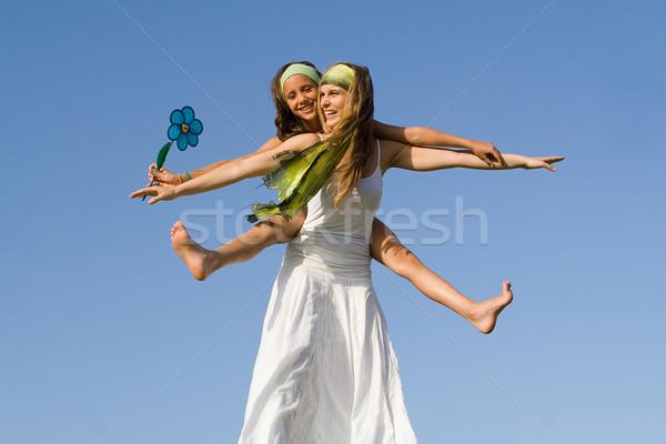 Boldog anyu játszik háton gyermek lány Stock fotó © godfer