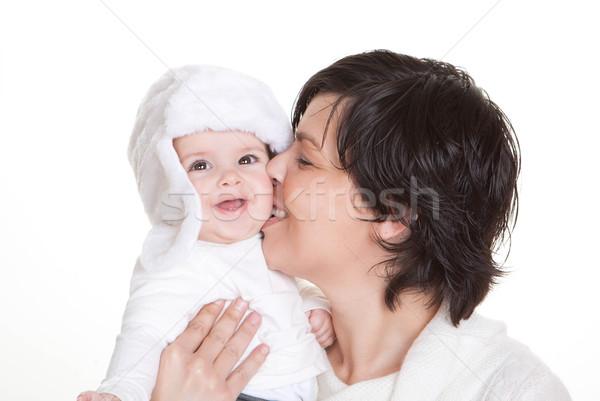 mum kissing baby child Stock photo © godfer
