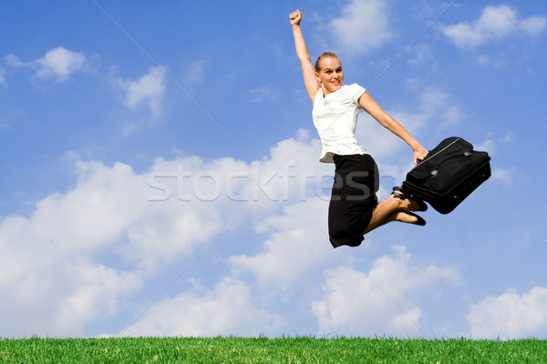 business concept - businesswoman jumping with success Stock photo © godfer