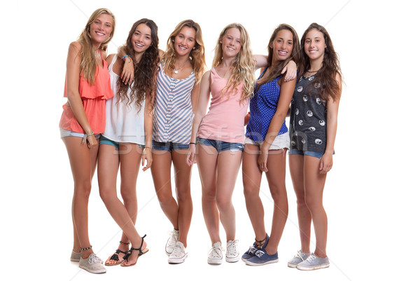 group of healthy tanned smiling summer teenagers Stock photo © godfer