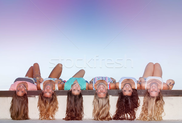 happy teens with long healthy hair laying upside down.  Stock photo © godfer