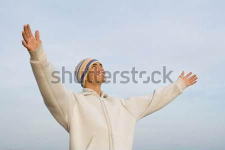 Boldog mosolyog spanyol fiatalember karok a magasban hit Stock fotó © godfer