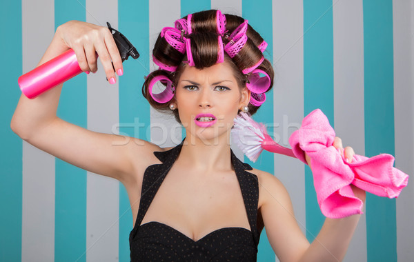 retro woman in rollers multitasking Stock photo © godfer