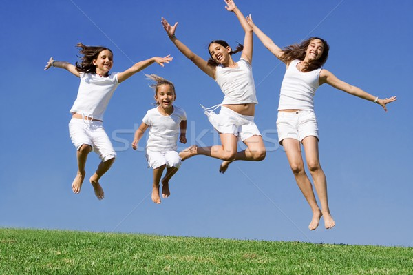 happy girls jumping at summer camp Stock photo © godfer