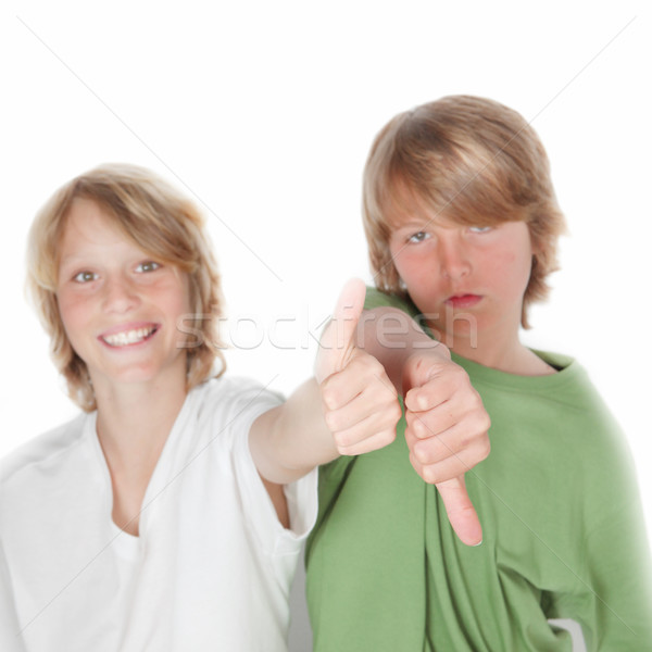 opposites, happy and sad, thumb up and thumb down Stock photo © godfer