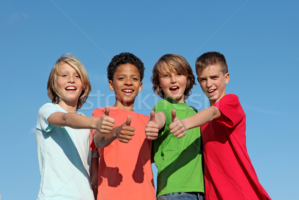 Stock photo: group of diverse kids at summer camp with thumbs up