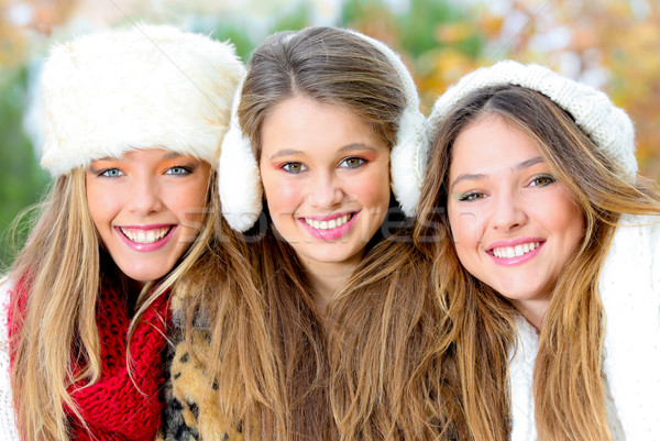 group of winter girls or young women with perfect white teeth Stock photo © godfer
