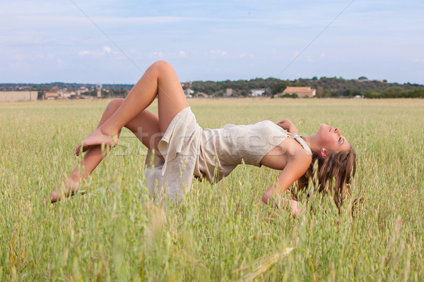 relaxation woman floating in field Stock photo © godfer