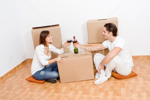 Boldog pár ünnepel új első otthon Stock fotó © godfer
