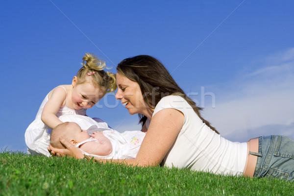 Anya gyerekek család szeretet fű fiatal Stock fotó © godfer