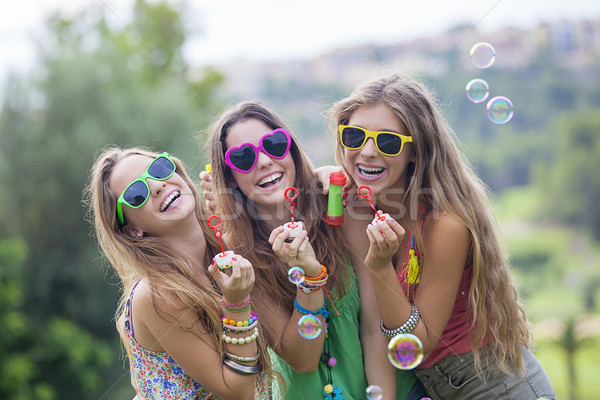 teen girls blowing bubbles Stock photo © godfer