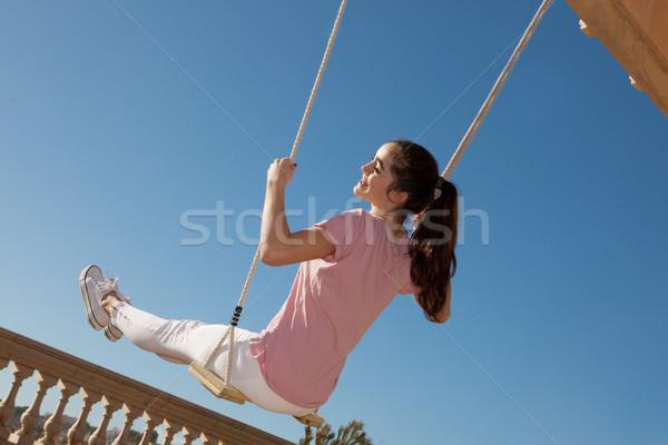 teen girl on swing Stock photo © godfer