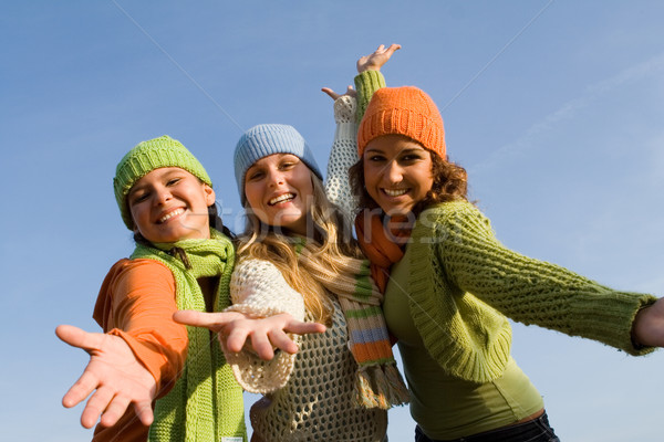 group of happy girls arms outstretched in welcome Stock photo © godfer