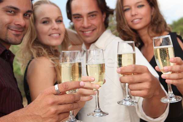 group of people toasting with champagne at party Stock photo © godfer