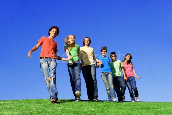 Racial grupo mãos meninas diversão Foto stock © godfer