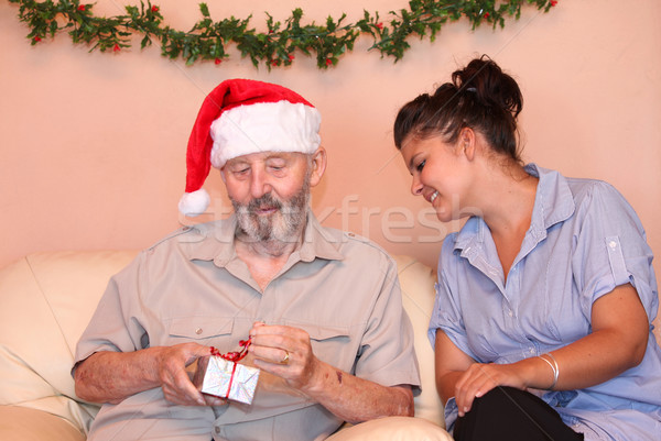 senior christmas with carer or grandchild wih gift Stock photo © godfer