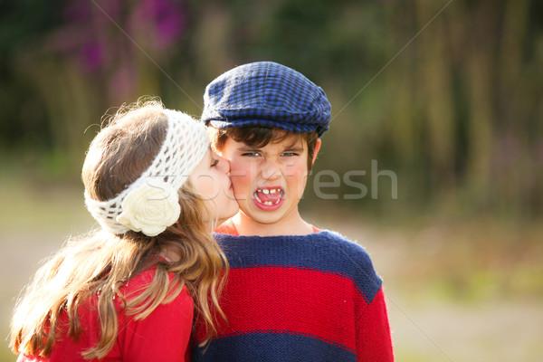 Gyerekek csók kislány fiatal megszégyenített fiú Stock fotó © godfer