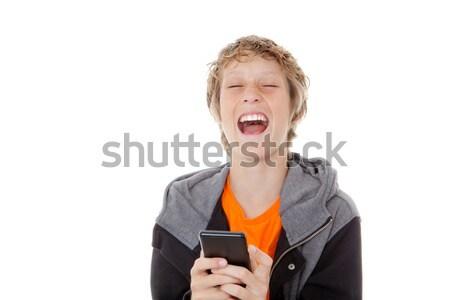 Cellule téléphone portable enfant rire lecture un message Photo stock © godfer