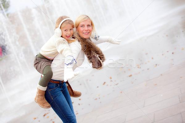 Boldog anyu gyermek háton mosolyog tél Stock fotó © godfer