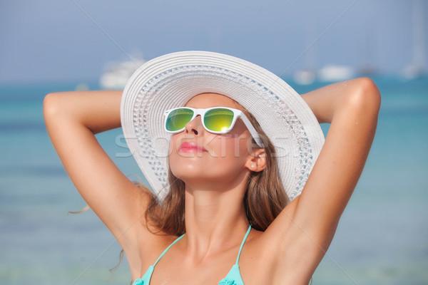 Nyugodt nő napsütés tengerpart Spanyolország lány Stock fotó © godfer