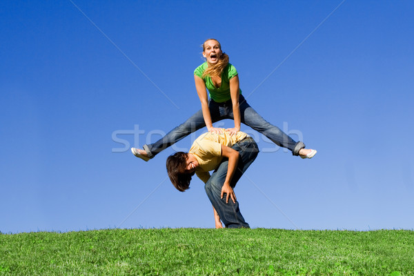active teens playing leapfrog Stock photo © godfer