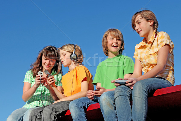 technology, kids playing with electrical gadgets Stock photo © godfer