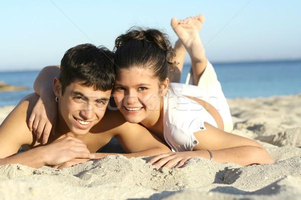 Boldog fiatal pér nyár tengerpart vakáció tavaszi szünet Stock fotó © godfer