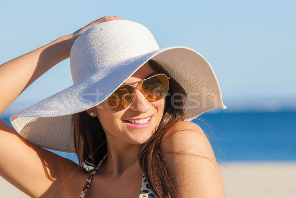 smiling summer woman with sunglasses and floppy hat Stock photo © godfer