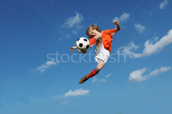child playing football or soccer Stock photo © godfer