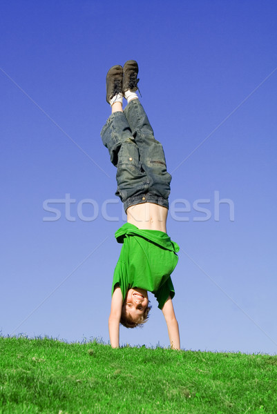 upside down child playing outdoors in summer Stock photo © godfer