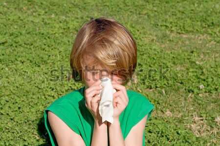 child with hayfever allergy sneezing into tissue Stock photo © godfer