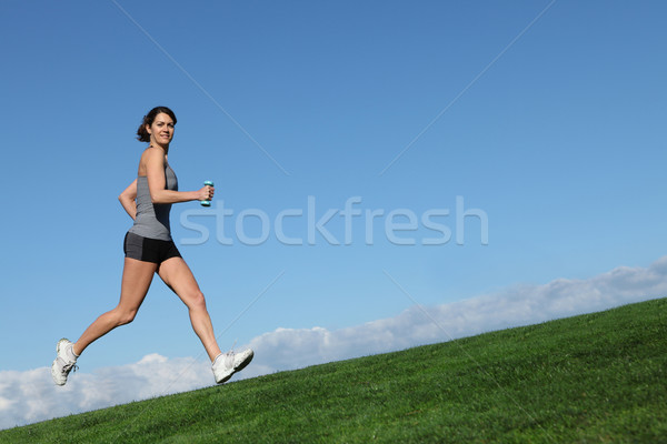 woman running or jogging Stock photo © godfer