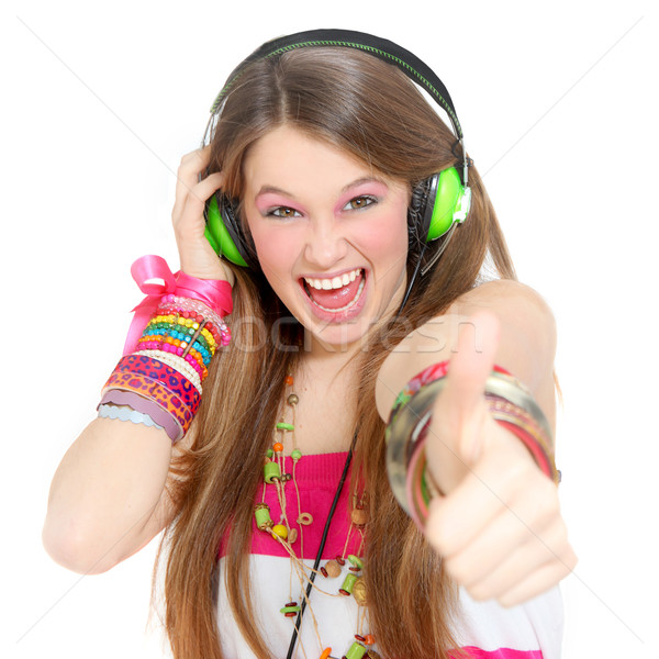 teen with headphones and thumbs up Stock photo © godfer