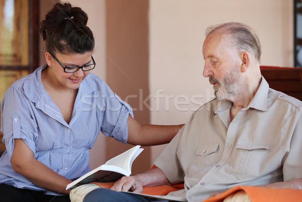 Gondozó olvas idős család férfi otthon Stock fotó © godfer
