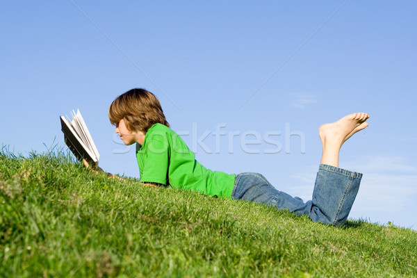 child reading book outdoors Stock photo © godfer