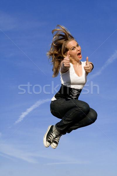 Boldog tini ugrik remek nő ugrás Stock fotó © godfer