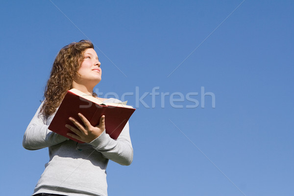 christian kid at bible camp reading gospel Stock photo © godfer