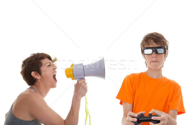angry mother of teen playing computer games Stock photo © godfer