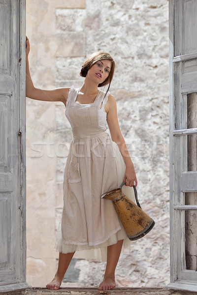 fashion girl, milk maid with jug Stock photo © godfer