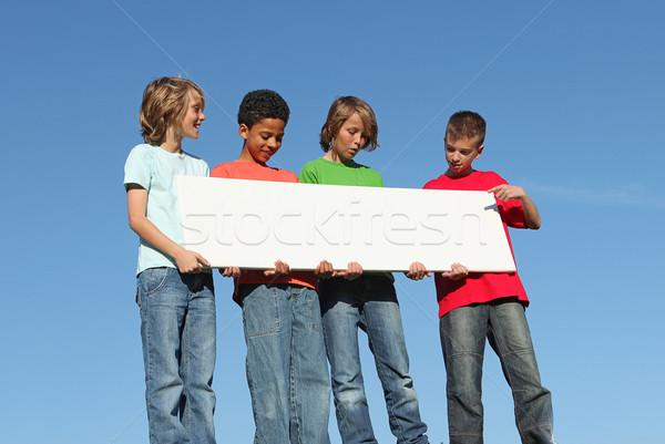 Groupe enfants blanche signe Photo stock © godfer