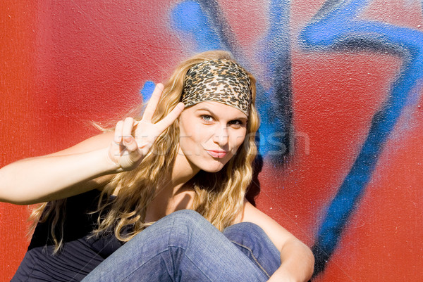 teen with fingers up in v sign or peace symbol Stock photo © godfer
