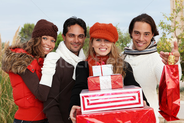Groupe fête cadeaux femmes heureux hommes Photo stock © godfer