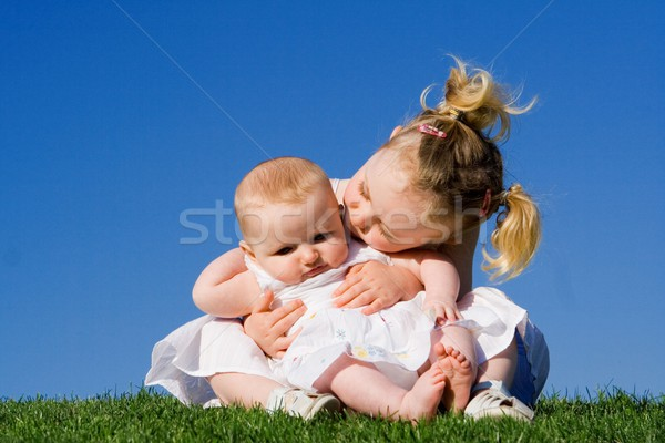 sisters, toddler and baby girls outdoors in summer Stock photo © godfer