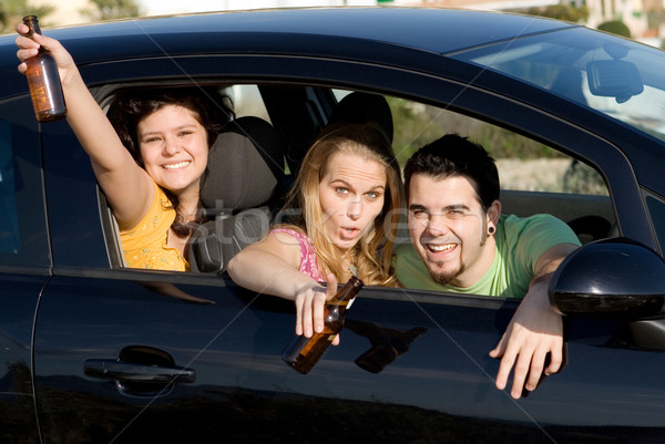 Underage drinking and driving, Stock photo © godfer