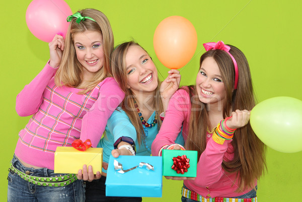 Stock photo: happy kids at birthday party giving wrapped gifts or presents