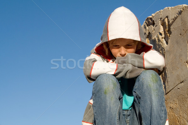 sad, lonely, unhappy , grieving, child sitting alone Stock photo © godfer