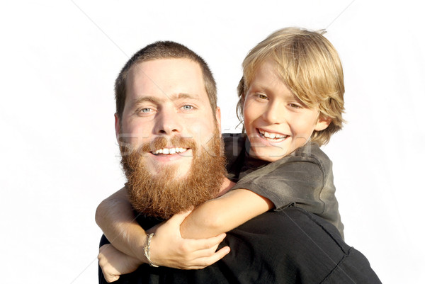 happy family, father and son playing piggyback Stock photo © godfer