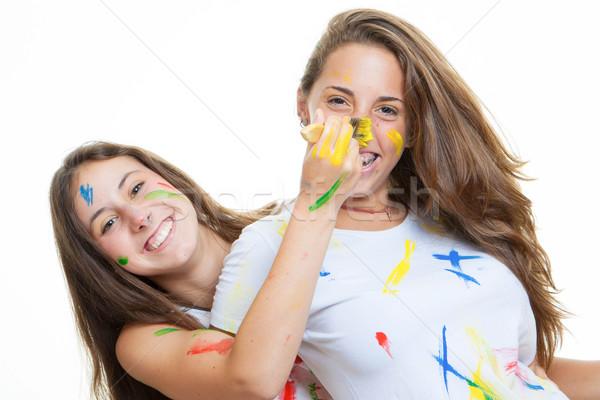 Játékos tini lányok festék lány mosoly Stock fotó © godfer